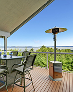Outdoor cooking with dining table and overlooking view